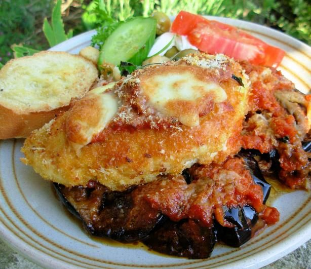 Oven Baked Chicken and Aubergine (Egg Plant) Parmigiana from Food.com: Parmesan crusted chicken breasts with meltingly tender aubergines in a tangy tomato sauce and a melted mozzarella topping, this tasty dish is great with ciabatta or baguette and assorted salad leaves. A wonderful version of the Italian classic where the chicken is quickly pan fried to seal in all those lovely juices before being oven baked for ease and convenience. This can be prepped earlier in the day making it a great…