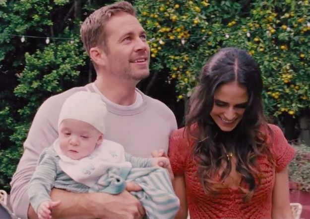 But the shot of Walker from Fast & Furious 6 with Jordana Brewster and their characters' baby makes a bigger impact.