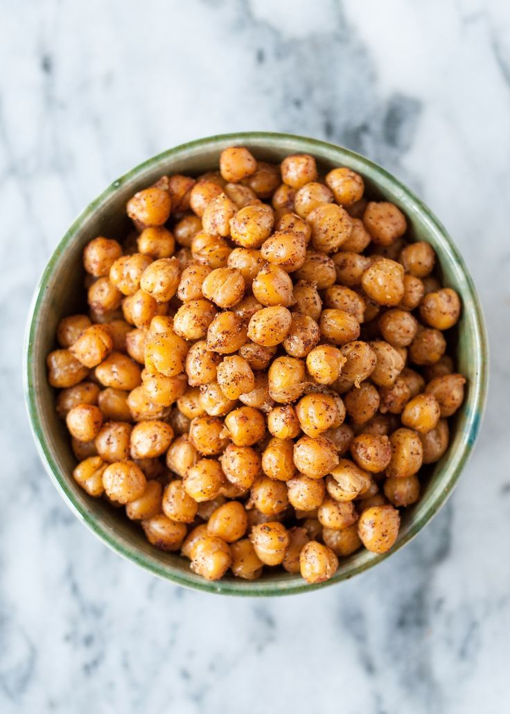 Those cans of chickpeas sitting in your cupboard have been hiding an amazing secret. Roasted in the oven, chickpeas transform into a crispy, salty, savory snack. So tiny. So easy to eat by the handful. So addictive. This is dangerous knowledge. If you haven't yet been introduced to this snack, please allow me to do the honors. Here is our step-by-step recipe for roasting chickpeas in the oven.