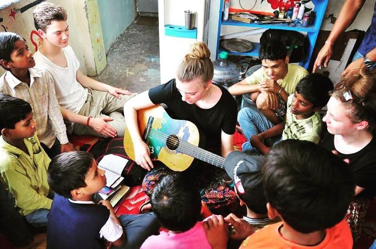 """Music touches us emotionally where words alone can't."" - Johnny Depp.  Volunteers at the Shelter Home in Delhi with the little ones.  #spreadlove #teach #music #heal #play #guitar #volunteering #India #humansofindia #sharingiscaring #lovefortravel #sharesomekindness #beloved #quotes #indiaphotoproject"