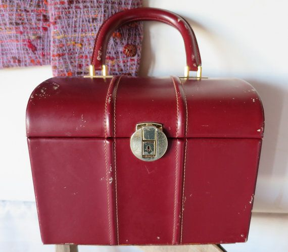 1950s red leather vanity case ~ in moderately good condition, but a rare colour for an item of this age. There is some slight marking to the front clasp / lock; visible in the photo, also the mirror is missing from the inside. The inside is in a bright vibrant yellow satin cloth interior with no visible stains. Perfect for make-up or jewellery or as an unusual and stylish bag.   Dimensions = Height = 8  - 20.5 cms Width = 10 1/4  - 26 cms Depth = 7 1/4  - 18...