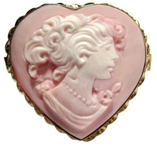 Cameo Ring Pink Heart Master Carved Italian Sterling Silver 18k Gold Overlay Italian Size 7.5 cameosRus. $124.00. Italian, one of a Kind, Imported, New,; Cameo Ring, Pink Conch Shell, Master Carved, Heart Shape,; 925 Sterling Silver, 18k Yellow Gold Overlay, Hand Made,  Collector's Item,; Collector's Item, Exceptional Value, Heirloom Jewelry,; Artisan Jewelry, One of a Kind, Size 7.5, The ring is Huge,. Save 67% Off!