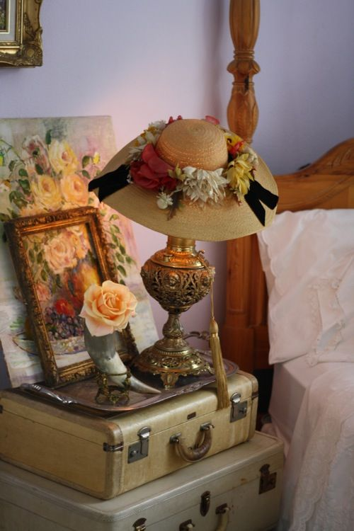 millinery flowers with the floral oil painting set against soft lavender walls
