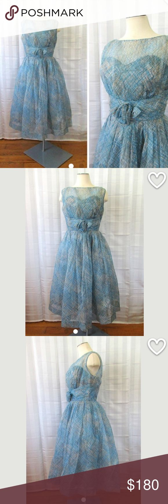 Vintage party dress 1950s prom frock blue 36 bust Pretty vintage party dress from the 50s, perfect for a formal. Sweetheart neckline with an overlay of sheer pleated fabric, with a fine net lining above the bust. 3-d flower. 3 layers-the top layer is a sheer fabric, possibly a rayon, the skirt has an under layer of white tulle. The bodice and skirt has a layer of soft taffeta like fabric as the final bottom layer.   Bust is 36 in. Waist is 28in. Hips open to 52 in. Length is 42 in. Long…