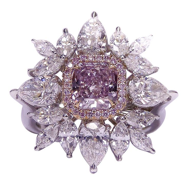 Fancy Pink Diamond Ring  USA  NEWAGE  1.28 CT fancy purple pink diamond in the center surrounded by 3.50 ct of marque and pear shape combination