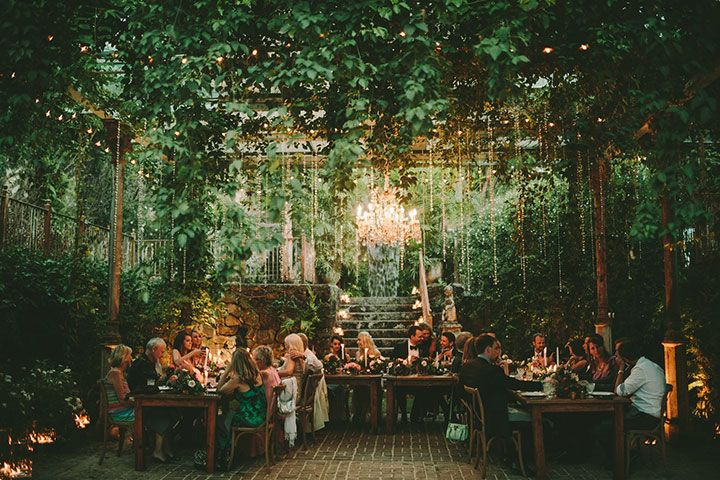 Magical at night with the French chandelier and suspended glass beads and lush tropical greens ~ we ❤ this! moncheribridals.com
