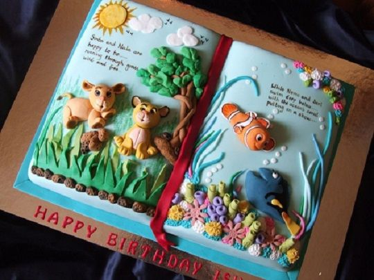 story book cake by Cake Central contributor Dods featuring the Lion King and Finding Nemo