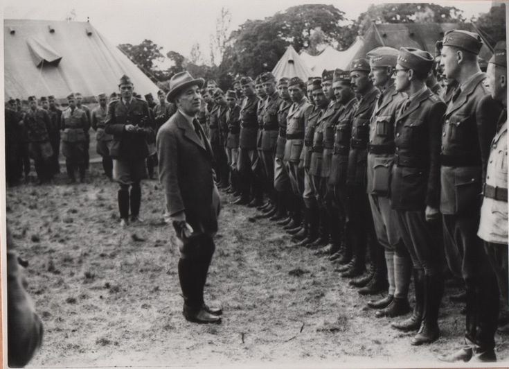 President Beneš visiting with Czech officers at Cholomdeley on 26 Jun 1940.