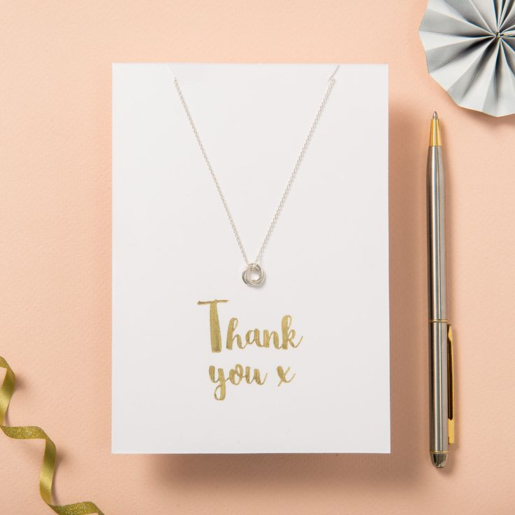 Posh Totty Designs Thank You Card and Necklace Set: A memorable thank you gift for a friend or loved one the Thank you Card and Necklace Set includes a dainty silver Petite Russian Ring Necklace. The card is gold foil metallic printed with the message 'Thank You x' and is blank inside for your message.  The card and necklace are made in our Brighton workshop. The card includes an envelope and cellophane wrapping.