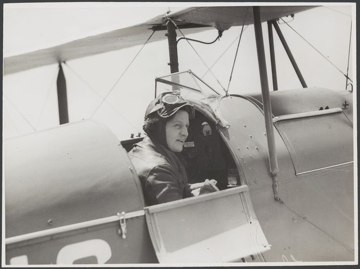 """Vintage photos from public archives.  When using, reference by stating """"no known copyright restrictions"""".  Freda Thompson sitting in the cockpit of a de Havilland DH.60G-III Moth Major, ca 1935"""