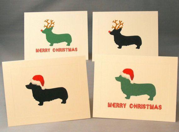 A set of Christmas Cards featuring Holiday Corgis. Four original designs: 1) Corgi Santa Black silhouette. 2) Corgi Santa Green silhouette, with