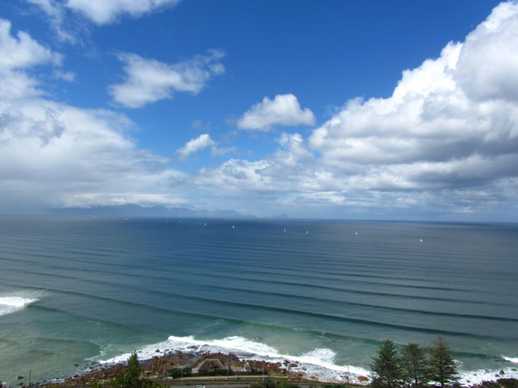 View from Boyes Drive - perfect surfing waves at Muizenberg. Muizenberg is the ideal beach for learning how to surf.  #KalkBay #Muizenberg #CapePointRoute #FalseBay #CapeTown #Surfing