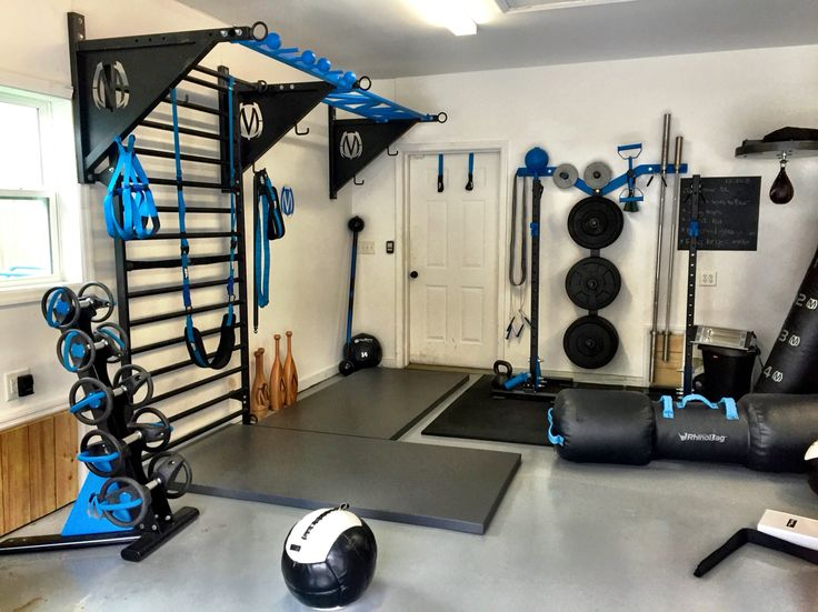 MoveStrong garage set up! DynaBells, pullup bracket system with stall bars, wall storage rack, Indy Squat stands, rhino bag, speed bag, and more!