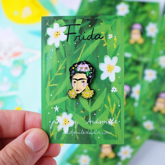 Frida is made from high quality black metal and featuring pink flowers & yellow statement earrings. Has a lapel pin back / butterfly metal clasp.  She is 2.5cm tall and 1.8cm wide.  Frida comes on a cute green floral card (inspired by her art). Designed & made with love, will be shipped with care.