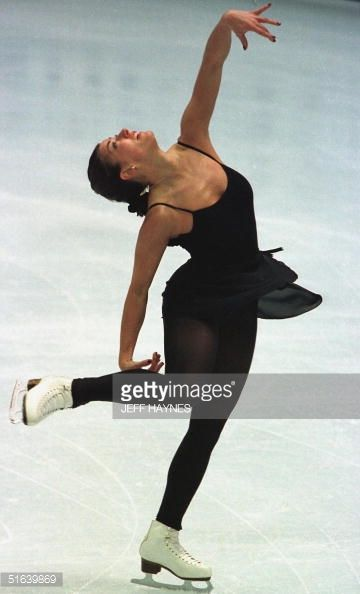 MINNEAPOLIS, UNITED STATES: Tonia Kwiakowski of the US glides on the ice during training for the World Figure Skating Champions ladies competition 27 March at the Target Center in Minneapolis, MN. Kwiakowski replaces 1998 Olympic gold medallist Tara Lipinski on the US team. Lipinski has swollen glands, recently had two teeth removed and cited tiredness as the reason for not competing here. AFP PHOTO Jeff HAYNES (Photo credit should read JEFF HAYNES/AFP/Getty Images)