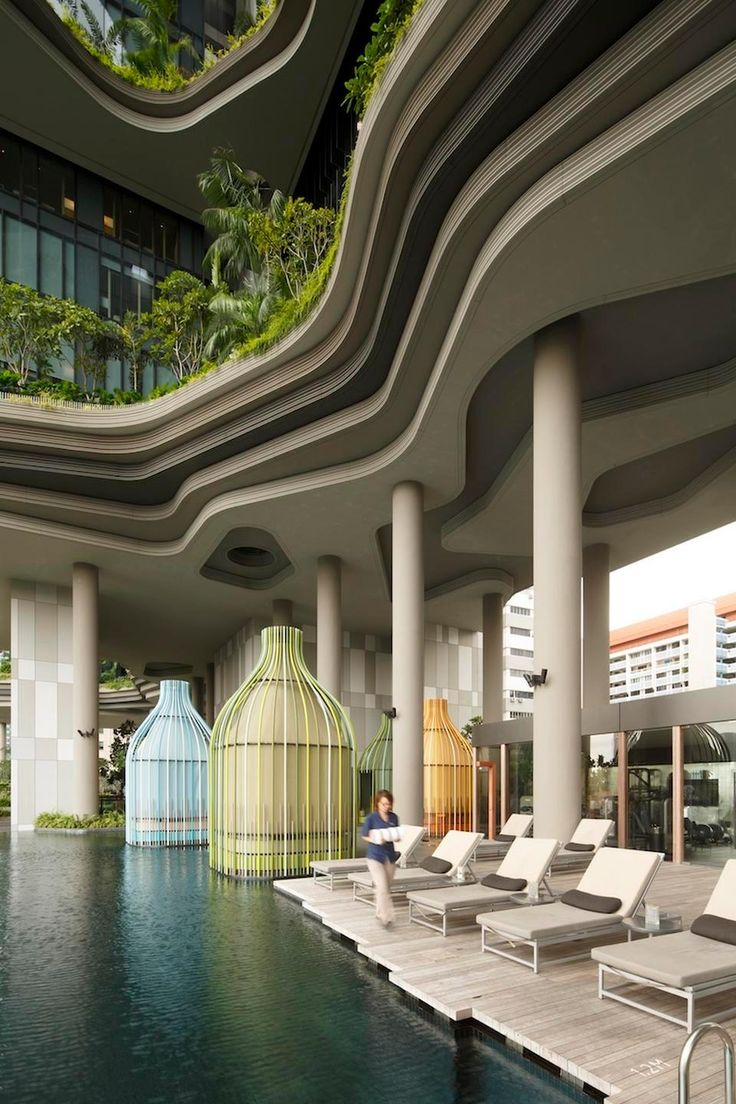 Stay at the stunning Park Royal on Pickering hotel in #Singapore if you love chic sustainable design: Solar panels line the roof while the Zen-like interiors include ponds, waterfalls, and a cabana-lined infinity pool. Photo by Darren Soh.