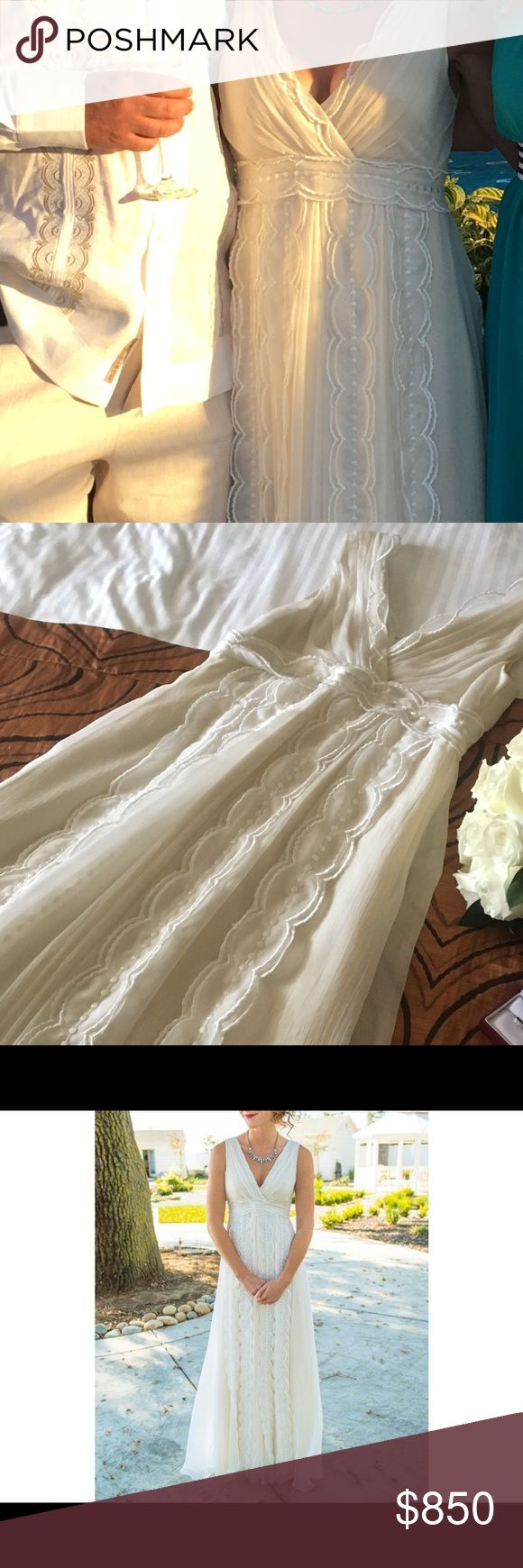 "Wedding dress Beautiful and elegant ivory Gently used wedding dress by SAJA (VN6656).  Super comfortable with its flowing design and very lightweight. Has snaps on the shoulder area to keep your undergarment in place. Shell and lining 100% silk. Measurements: shoulder to hem 52"", armpit to armpit 15"", empire waist 14.5"" laying flat. Size 4. Perfect for a beach or garden wedding! Has been dry cleaned. Saja Dresses Wedding"