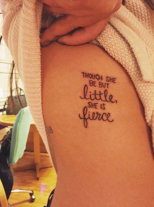 "Little side tattoo saying ""Though she be but little, she is fierce"", a quote by Shakespeare."