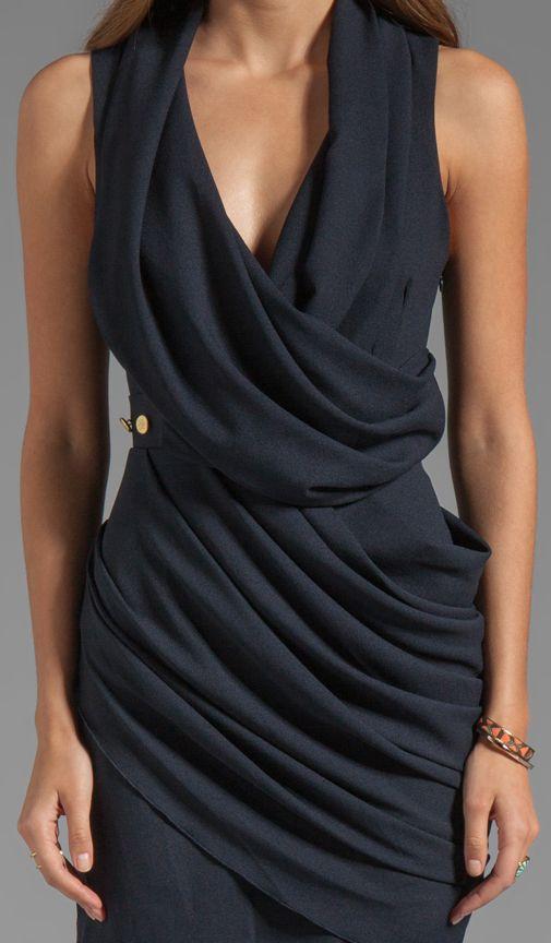 Draped dress. …