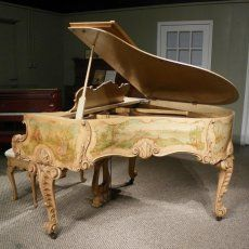 Vintage baby grand piano...beautiful