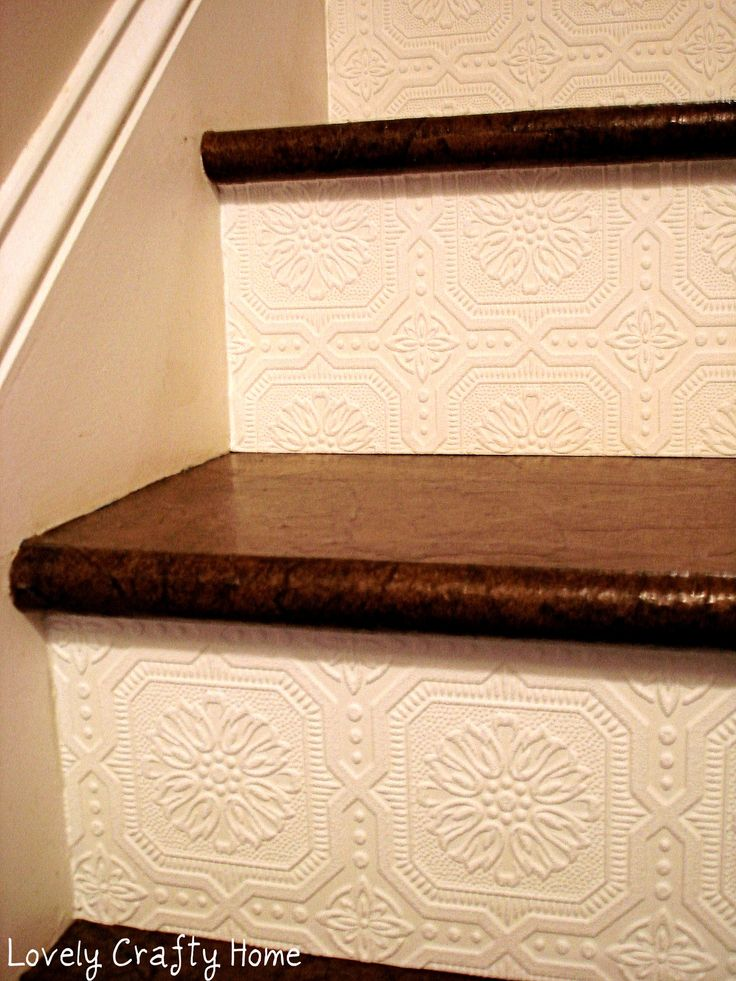 Wallpaper on stair risers, simple way to add texture and character! This also looks like the metal ceiling plates.