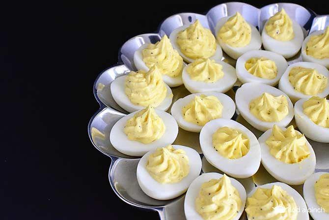 Classic Deviled Eggs Recipe from addapinch.com