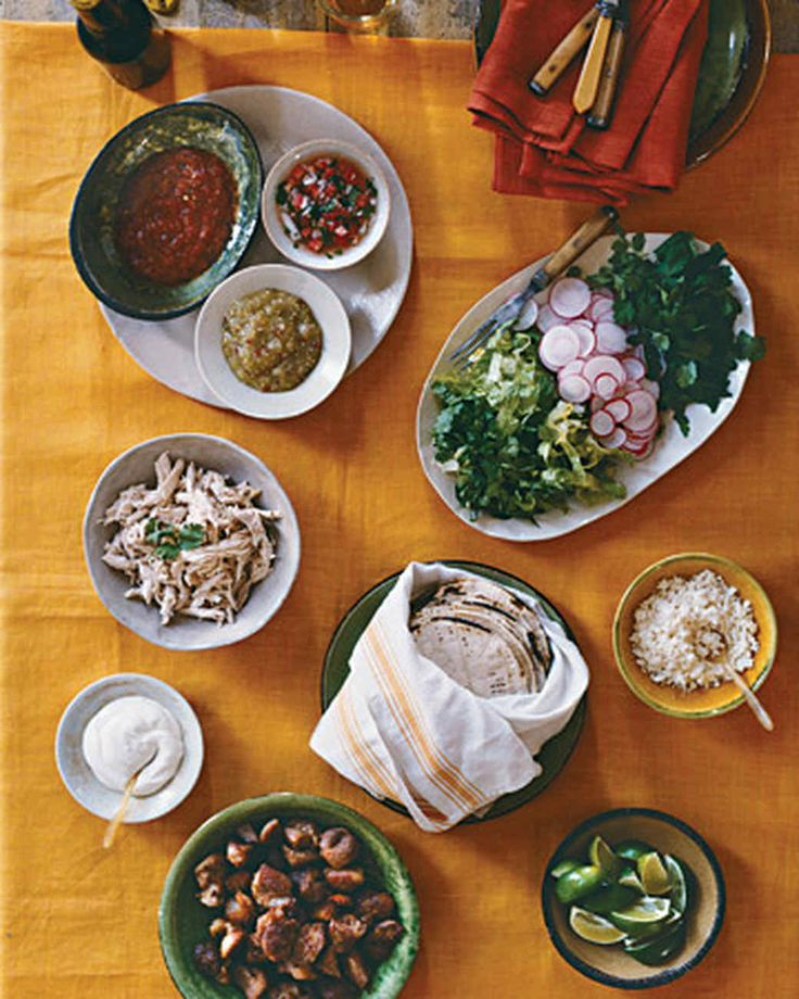 A taco bar lets guests select their favorite fillings and fixings, choosing from chicken, pork, lettuce, radishes, cilantro, cheese, sour cream, salsas, and a squeeze of lime.