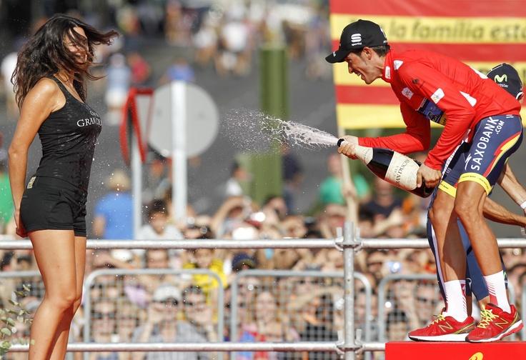 Alberto Contador sprays bottle of cava on a girl after his Vuelta victory.