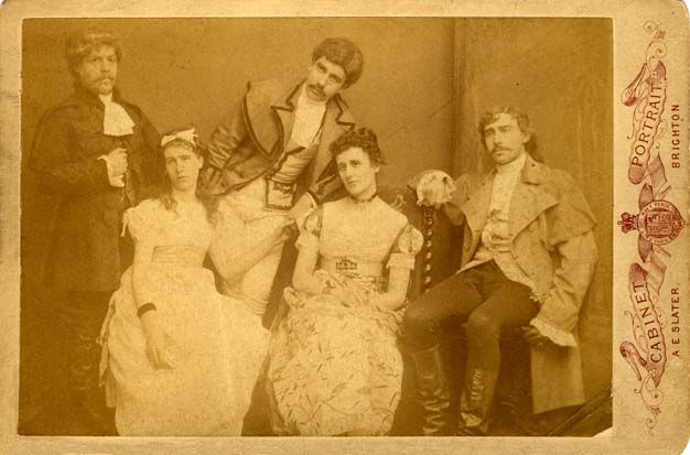 """1883 Fancy Dress  A cabinet portrait of a group of young people wearing 18th century costume, photographed by A. E. Slater of 24 St Georges Road, Brighton. Although they could be mistaken as a troupe of actors and actresses, this group were probably on their way to a fancy dress ball or historical pageant. The photographer Albert Edward Slater ( born 1863, Brighton ) began his working life as a hairdresser's assistant, but  he set himself up as a """"Photographic Artist"""" at 24 St Georges Road."""