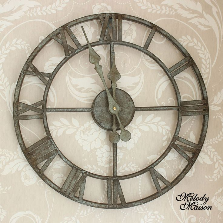 Industrial Style Skeleton Wall Clock Exquisite design, would look fabulous in a rustic loft style setting Perfect for your conservatory as it has a weathered vintage look With a Roman numeral clock face. (If used outdoors, we would advise protect from the worst elements, and wrap battery case in cling film or similar to avoid damp) There is a bracket to the rear for hanging purposes, one battery is required