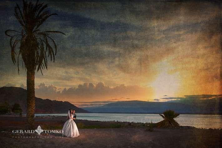 Fine art Bride and Groom portrait at sunset. Del Bono Beach Complejo Bahia, San Juan. Argentina destination wedding. Day after session. Wedding Photographer | Gerard Tomko.