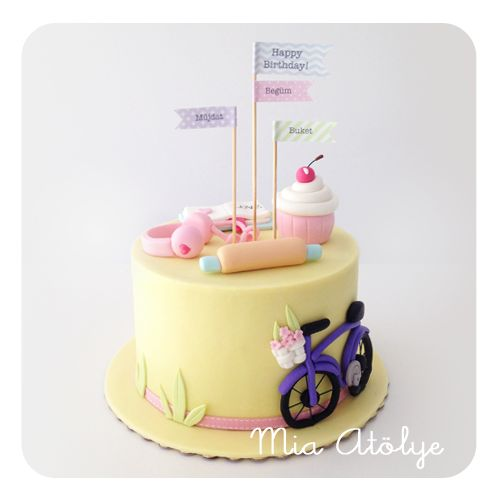 Bicycle cake with paper banners