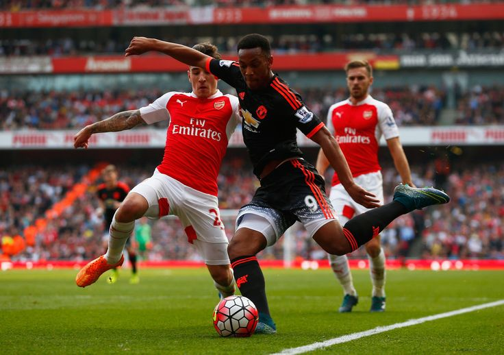 Anthony Martial of Manchester United and Hector Bellerin of Arsenal in action during the Barclays Premier League match between Arsenal and Manchester United at Emirates Stadium on October 4, 2015 in London, England. (Oct. 3, 2015 - Source: Julian Finney/Getty Images Europe)