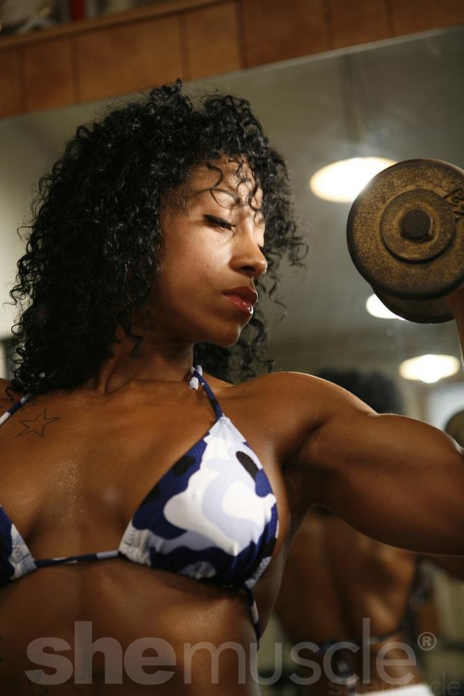 A fine example of female biceps made in the gym.