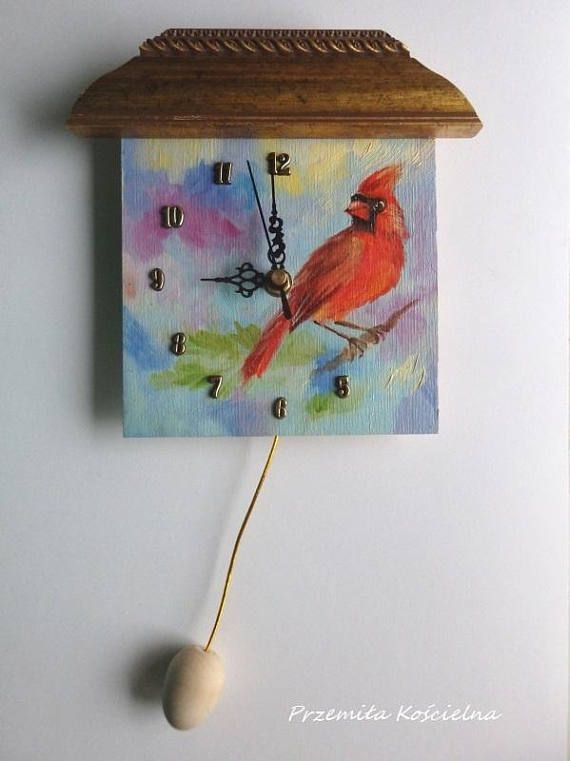 Unique handmade painted wall clock This is funny little wall clock designed and manufactured by artist Przemila Koscielna (P.Pizl) The clock face is an ORIGINAL OIL PAINTING showing a wildlife Cardinal Songbird. Title: LITTLE BIRD Little christmas scene with red bird This funny bird portrait is handmade painted with oil paints on the clock face. colors: blue, red and gold Painted on wooden panel Painting is signed. size of painted face : 15 x 15 cm = 6 x 6 inch #clock #handmade #christmas…