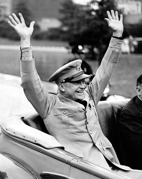 General Dwight Eisenhower raises both arms and acknowledges the New York crowd's cheers. An estimated 4 million people turned out for his V-E (Victory in Europe) parade on June 6, 1945. (CSU_ALPHA_260) CSU Archives/Everett Collection