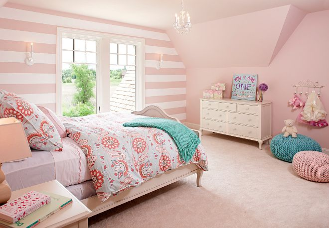 This pink girl's bedroom is so sweet! Walls are covered in a Serena & Lily Stripe Wallpaper and the pink paint color was custom to match the wallpaper.  Lighting is Crystorama. pink-stripes-in-girls-bedroom #girlsbedroom #pinkgirlsbedroom Vivid Interior Design. Hendel Homes