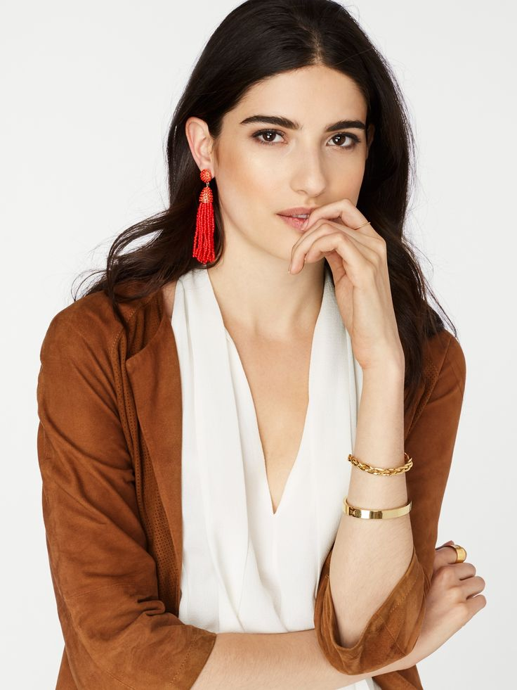 Bold beaded tassel earrings are a fresh, festive approach to a monochromatic outfit.