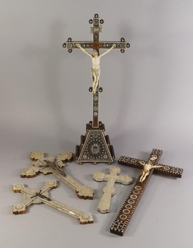 An ivory and mother of pearl Jerusalem crucifix, 18th century, on a tapering stand, 62cm high, together with a collection of other Jerusalem crucifixes, various dates, mostly 19th century(5) - Price Estimate: £500 - £800