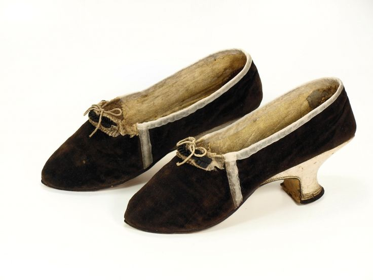 Pair of woman's shoes, c. 1770-1780. Dark brown silk velvet, white and brown striped silk ribbon.