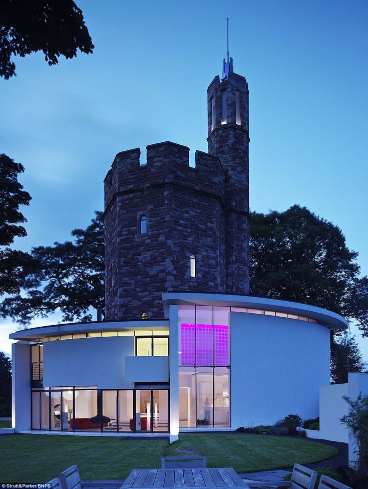 This 19th-century water tower was transformed into a stunning modern home by its current ownersRussell and Jannette Harris - and could be yours for £2.5million