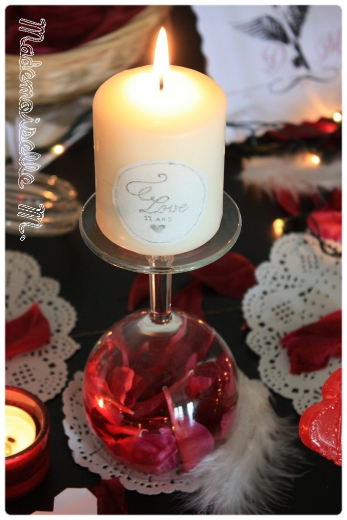 Cool candle holder idea. Upside down Wineglass with red rose petals and candle on top! <3