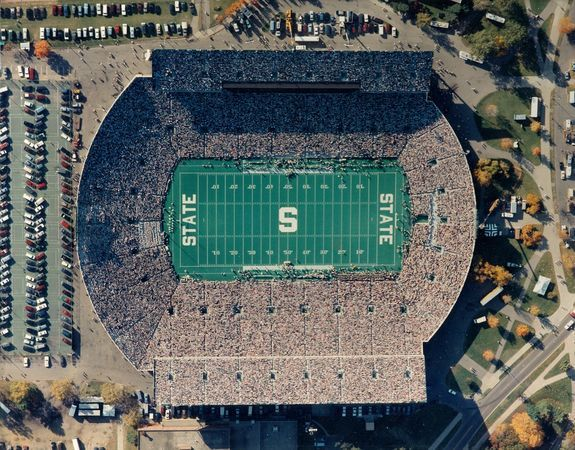 Spartan Stadium with its memorable AstroTurf as it looked in 1989. Michigan State installed a natural grass field in 2002. (Courtesy of Michigan State Athletic Communications)
