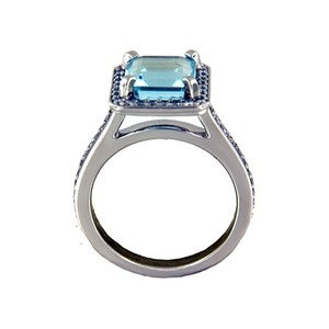 Fancy Diamond Halo Aquamarine Ring    A brilliant halo of pavé-set diamonds frames the center step-cut aquamarine in this incredible ring. Diamond accents grace a thin and feminine band to further accentuate the vibrant center gemstone.    Prices starting at CAD 3,075
