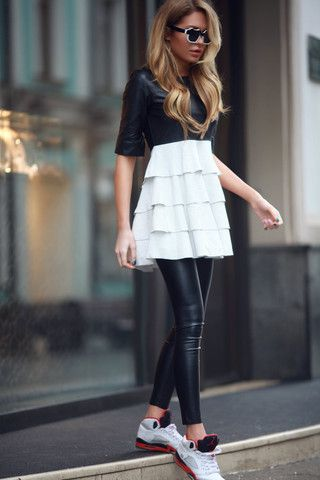 Mini black and white dress with a ruffled skirt. Wear it with sneakers and a cross-body bag.