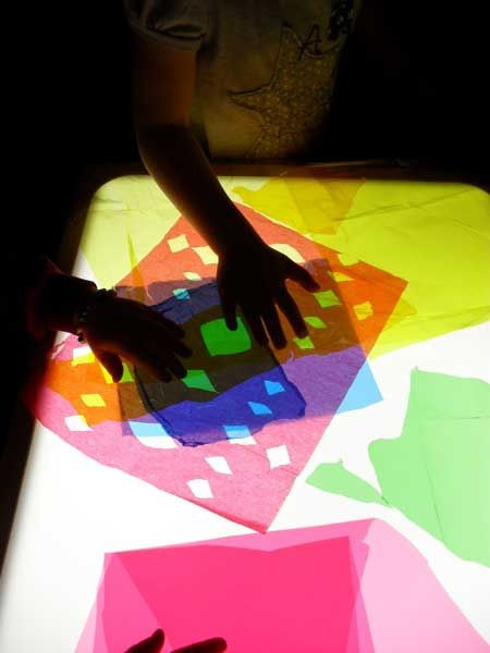Cutting & scrunching tissue paper on the light table