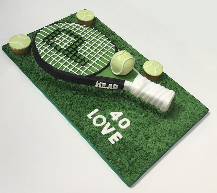 Tennis racquet cake with edible tennis ball and tennis ball cupcakes.The Cake Lab Bakery, Ranelagh, Dublin, Ireland. Artisan Baking Studio.