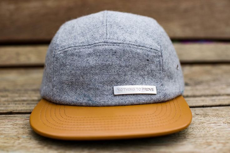 "This hat is the debut of our new ""Nothing to prove""™ collection We named it ""Old Soul New Body . The cap is made out of a grey melton wool, and the brim is made out of a tan Morocco leather."