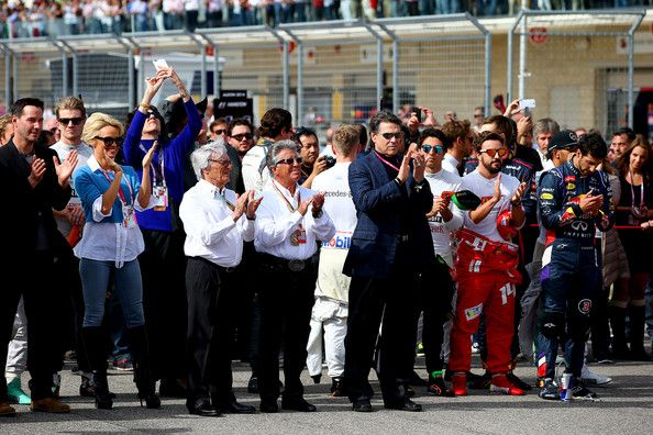 Keanu Reeves Photos Photos - F1 supremo Bernie Ecclestone, former champion Mario Andretti, actors Keanu Reeves and Pamela Anderson and the drivers stand for the national anthem before the United States Formula One Grand Prix at Circuit of The Americas on November 2, 2014 in Austin, United States. - F1 Grand Prix of USA