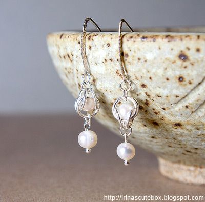 Sterling silver dangle earrings with pearl